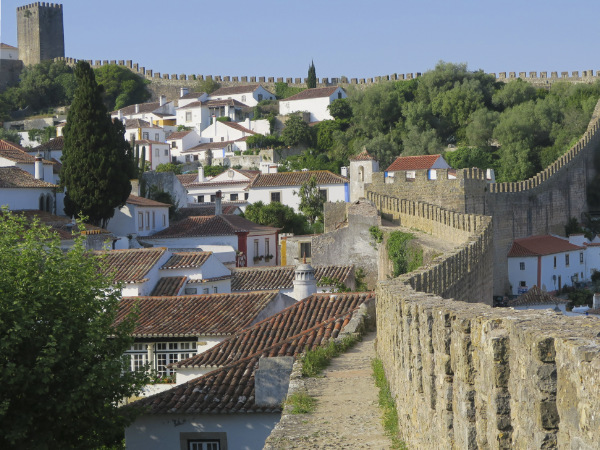 A view along the medieval walls of Obidos castle to the town