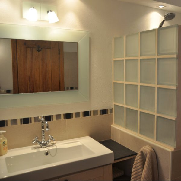 A large sink and mirror in a stylish bathroom