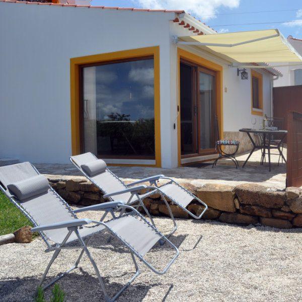 A sunny terrace and garden area