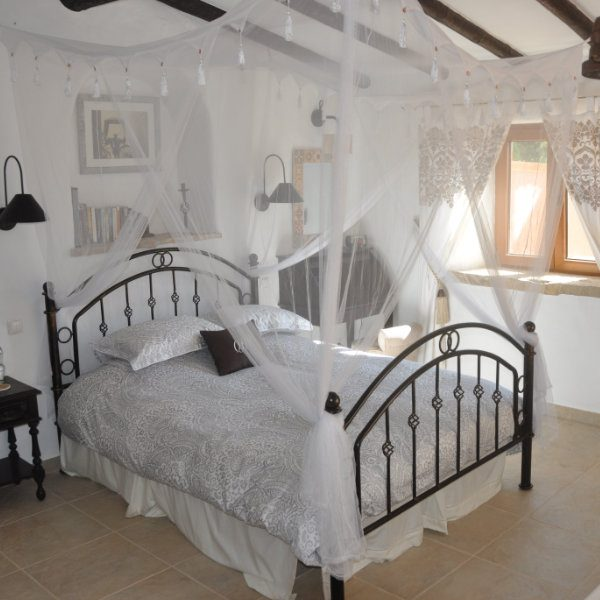 A romantic bed with soft canopy